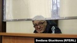 Bakhytzhan Kashkumbaev appears in court in Astana on January 22.