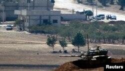 Түркия-Сирия шекарасында тұрған танк. (Көрнекі сурет)