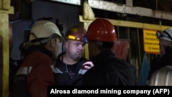 A handout picture provided by Russia's diamond miner Alrosa shows rescue personnel at the Mir diamond mine in the Sakha region on August 4.