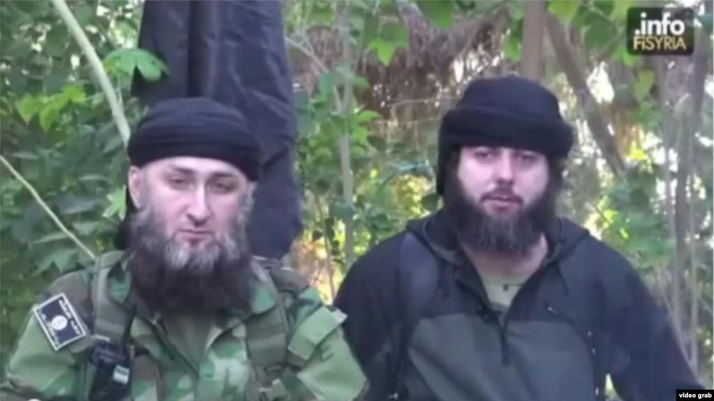 0025da885 In the video, a man believed to be Akhmed Chatayev (right) appears alongside