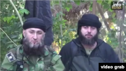 In the video, a man believed to be Akhmed Chatayev (right) appears alongside the notorious Islamic State militant Abu Jihad, a close confidante of the group's commander in Syria, Umar al-Shishani.