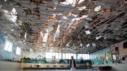 AFGHANISTAN -- An Afghan man inspects a damaged wedding hall after a blast in Kabul, Afghanistan August 18, 2019.