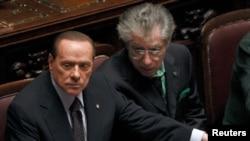 Международные комментаторы называют внутреннюю политику Италии водевилем во многом благодаря скандалам, связанным с премьер-министром страны Сильвио Берлускони (на фото слева)