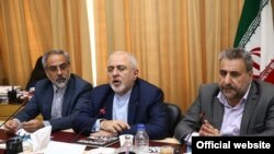 Iranian foreign minister Mohammad Javad Zarif (C) and Iranian MP Heshmatollah Falahatpisheh (R). File photo