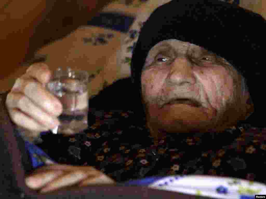 Antisa Khvichava rests at her home in the village of Sachino, west of the Georgian capital Tbilisi. - Khvichava claims to have been born in 1880, making her the oldest person in the world. Photo by David Mdzinarishvili for Reuters