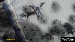 Скриншот видеозаписи действия в аэропорту Донецка, снятой с беспилотника. 15 января 2015 года.