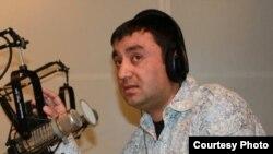 Cанжар Эралиев.