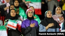 """The presence of women in stadiums is harmful,"" warned Iran's chief prosecutor, Mohammad Javad Montazeri. A select group of women watched the friendly with Bolivia in Azadi Stadium in Tehran on October 16 (above)."