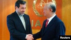يوکيا آمانو دبير کل آژانس بین المللی اتمی و عباس عراقچی، معاون وزیر امور خارجه ایران