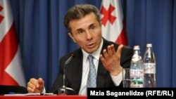 Georgian Prime Minister Bidzina Ivanishvili made a demand for President Mikheil Saakashvili's resignation one of his first major moves after winning elections in October, before backing away from that hard line.