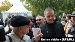 The foreign funding is at the heart of allegations leveled against Russian opposition leader Sergei Udaltsov (right).