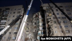 PHOTO GALLERY: Suspected Gas Explosion Devastates High-Rise In Russia's Magnitogorsk (CLICK TO VIEW)
