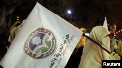 Supporters of the Muslim Brotherhood march ahead of parliamentary elections.