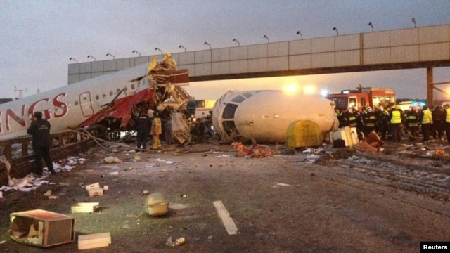 The  wreckage of the Tupolev Tu-204 airliner is seen on a highway near Moscow's Vnukovo Airport on December 29.