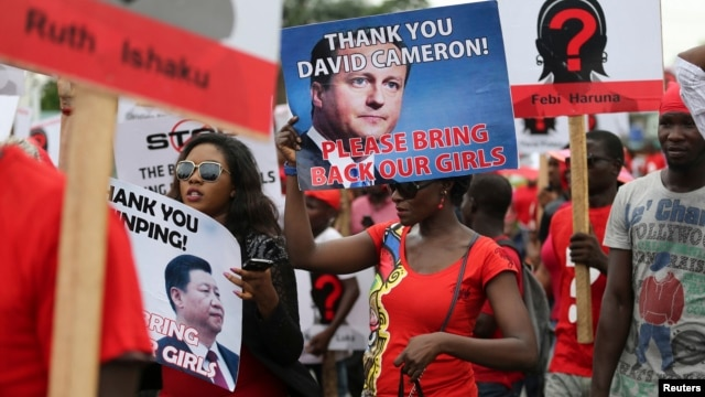 Demonstrators carry signs as they attend a protest in Lagos on May 9 demanding the release of the more than 250 school girls abducted by militants in the remote village of Chibok.