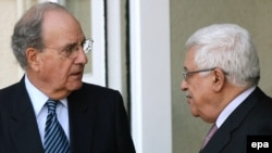 U.S. special envoy George Mitchell (left) with Palestinian President Mahmud Abbas in Ramallah in January