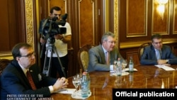 Armenia - U.S. Ambassador Richard Mills (L) and ContourGlobal CEO Joseph Brandt (C) meet Prime Minister Hovik Abrahamian, Yerevan, 8Jun2015.