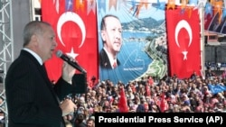 Turkish President Recep Tayyip Erdogan addresses the supporters of his ruling Justice and Development Party during a rally in Eregli, March 19, 2019