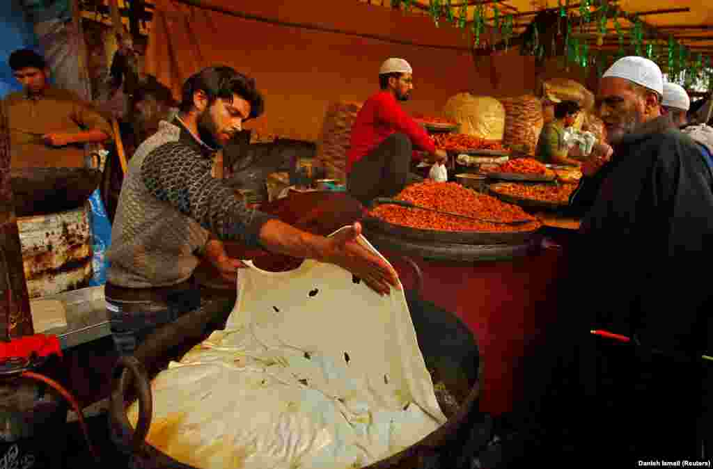 A vendor prepares traditional bread during the festival of Eid-e-Milad-ul-Nabi, the birth anniversary of the Prophet Muhammad, outside the Hazratbal shrine in Srinagar. (Reuters/Danish Ismail)
