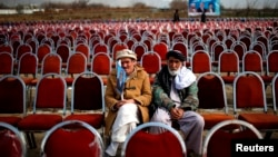 Supporters of presidential candidate Abdullah Abdullah wait for the start of an election rally in Parwan Province on March 20.