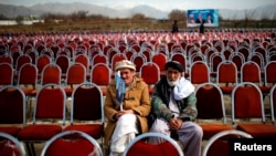 Supporters of presidential candidate Abdullah Abdullah wait for the start of an election rally in Parwan Province.
