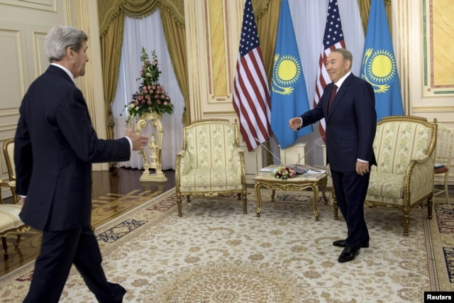 U.S. Secretary of State John Kerry (left) is greeted by Kazakh President Nursultan Nazarbaev before meeting at the Presidential Palace in Astana on November 2.