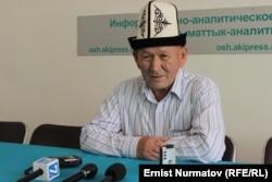 Курманбек Шоноев.