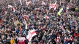 BELARUS – Opposition supporters carrying former white-red-white flags of Belarus parade through the streets during a rally to protest against the Belarus presidential election results in Minsk on October 18, 2020