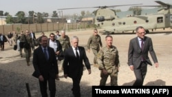 FILE: U.S. Defense Secretary Jim Mattis (2nd left) arrives at NATO's Resolute Support mission in Kabul in September.