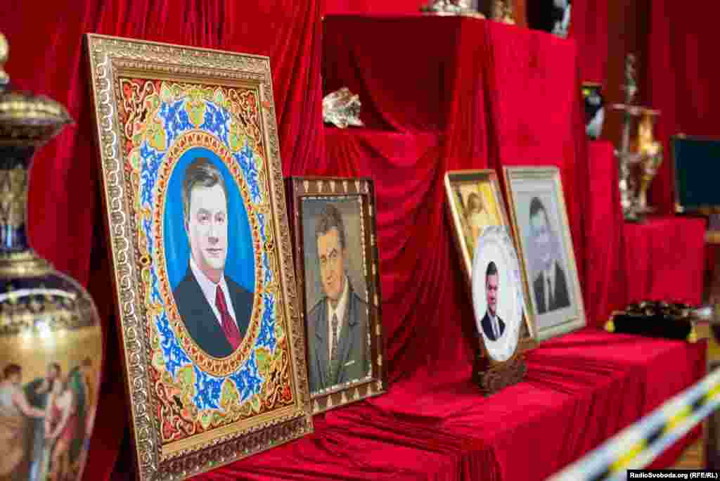 Portraits of former President Viktor Yanukovych greet visitors to the museum exhibit.