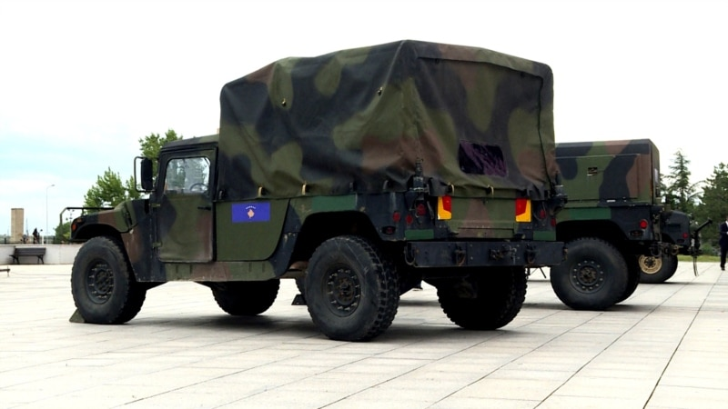 Humvees Shine Headlights On Kosovo's Controversial Vote On Army