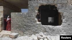 Дом в Алеппо, поврежденный ракетой