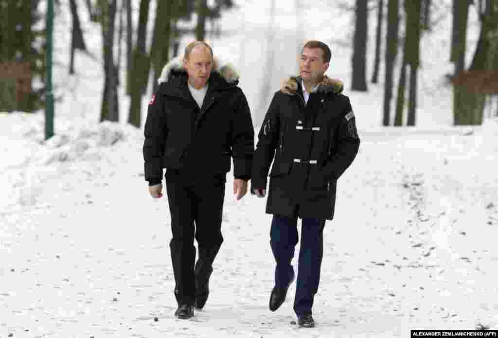 Putin and Medvedev walk outside Moscow on February 29, 2008. When a two-term limit prevented Putin from running for president again in 2008, he named Medvedev, then first deputy prime minister, as his preferred successor.