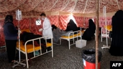 Yemenis suspected of being infected with cholera receive treatment at a makeshift hospital in Sanaa.