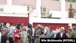Voters wait to take part in Egypt's referendum on March 19.