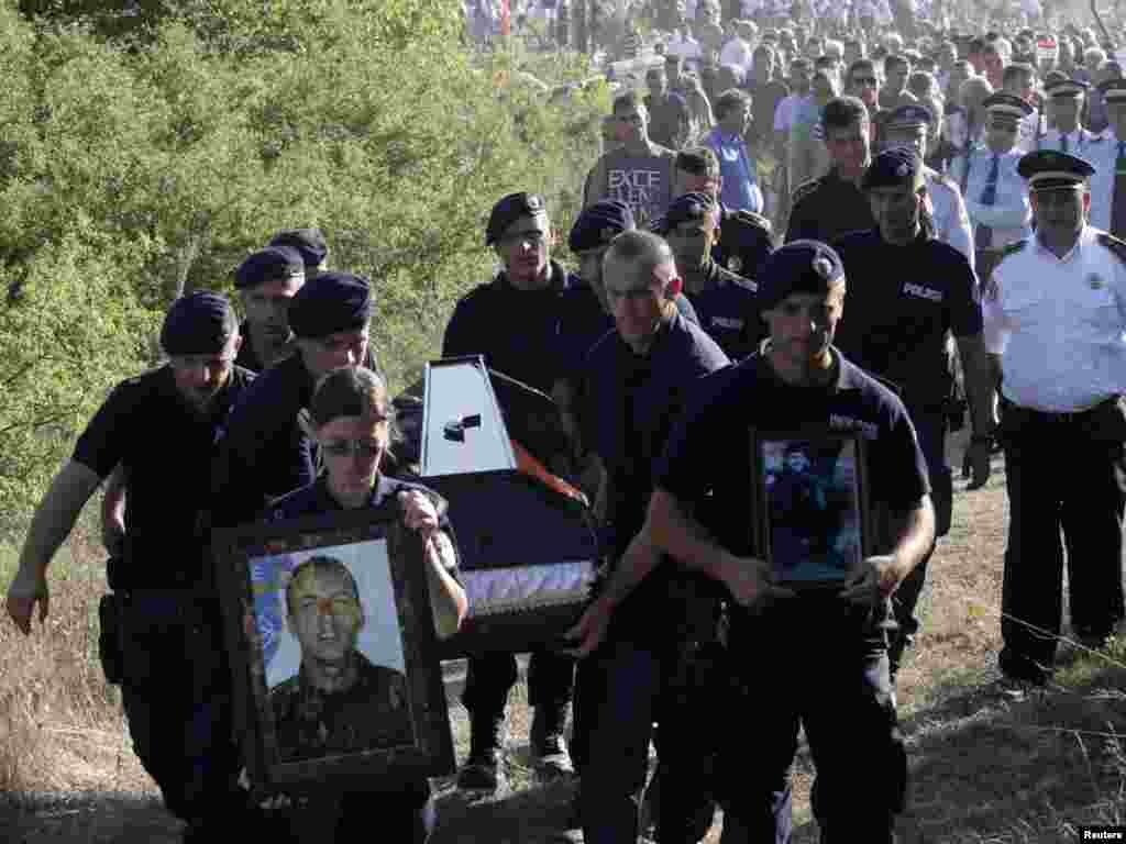 Members of the Kosovo special police unit carry the coffin of Enver Zymber at his funeral on July 27.