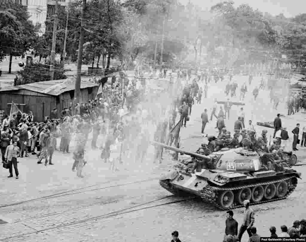 I awoke early the morning of August 21st to the rumble of tanks and the sounds and sights of a full-blown military occupation. I looked out the window, expecting to see trucks; instead I saw Soviet tanks wheeling into position on the campus, blocking all entrances and exits.