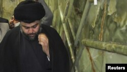 Shi'ite cleric Muqtada al-Sadr visits the Imam Ali shrine on his return to Iraq, in Al-Najaf, on January 5.