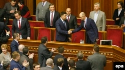 Former Prime Minister Arseniy Yatsenyuk (right, on podium) is included on the list.