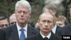 Former U.S. President Bill Clinton (left) and Russian President Vladimir Putin attend the funeral of Putin's predecessor, Boris Yeltsin, in Moscow in April 2007.