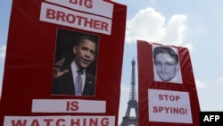 Demonstrators in support of Edward Snowden rally in Paris on July 7.