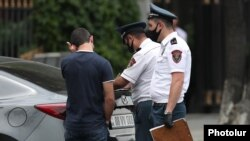 Armenia -- Police officers fine a car driver for violating coronavirus-related safety rules, Yerevan, June 2, 2020.