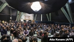 Iranian students attend a memorial for the victims of the Ukraine plane crash at the University of Tehran in January.