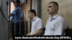 Former Berkut officers Serhiy Zinchenko (left) and Pavlo Abroskin appear in court in Kyiv in August 2015. Neither appears likely to face trial in Ukraine now.