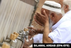 A man performs wudu (ablution) before Friday Prayers in Peshawar during the Muslim holy month of Ramadan amid the coronavirus lockdown in Khyber Pakhtunkhwa Province.