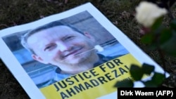 A flyer during a protest outside the Iranian embassy in Brussels for Ahmadreza Djalali, an Iranian academic detained in Tehran for nearly a year and reportedly sentenced to death for espionage, February 13, 2017