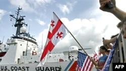 "Georgians welcome the U.S. Coast Guard cutter ""Dallas"" in the Black Sea port of Batumi on August 27, 2008."