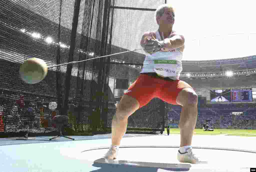 Anita Wlodarczyk of Poland on her way to winning the gold medal and setting a new world record in women's hammer throw