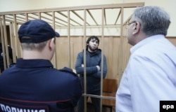 Zaur Dadayev (center), one of the main suspects in Nemtsov's killing, stands in a cage in a Moscow courtroom on August 25.