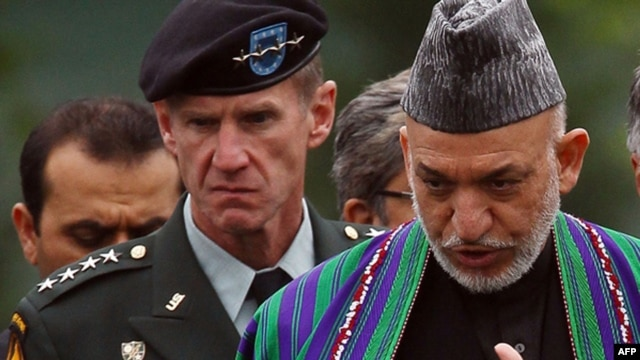 U.S.General Stanley McChrystal (left) with Afghan President Hamid Karzai at Arlington National Cemetery during a Washington visit in mid-May.